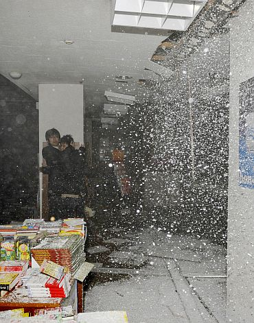 People take shelter as a ceiling collapses in a bookstore