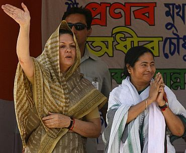 Congress chief Sonia Gandhi with Trinamool chief Mamata Banerjee at a poll rally in West Bengal