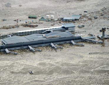 Sendai Airport is flooded after a tsunami following an earthquake in Sendai