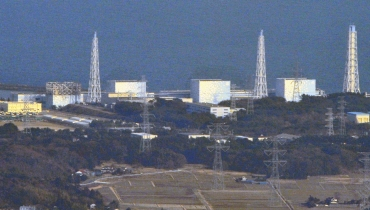 The damaged upper structure of Tokyo Electric Power Co.'s Fukushima Nuclear Plant reactor No 1