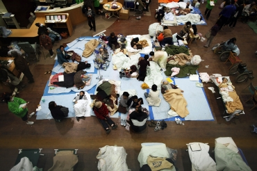 People are given first aid at a Japanese Red Cross hospital