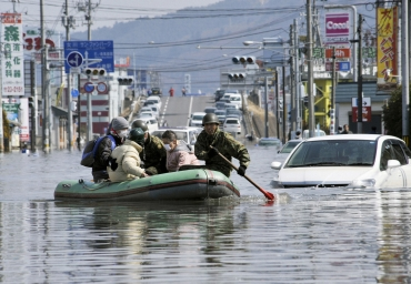 Japan Self Defence Forces troops rescue people from flooded areas in Ishimaki City