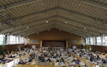 Evacuees, who fled from the vicinity of Fukushima nuclear power plant, rest at an evacuation center set in a gymnasium in Kawamata, Fukushima Prefecture in northern Japan
