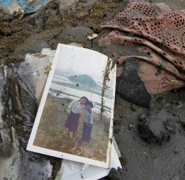A photograph is seen among rubble in Higashimatsushima City, Miyagi Prefecture in northern Japan