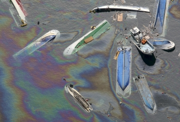 Oil leaks from ships swept by a tsunami in Fudai Village, Iwate Prefecture in northern Japan