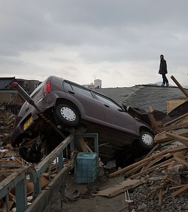 A man stands amidst the destruction in Kesennuma City on March 15