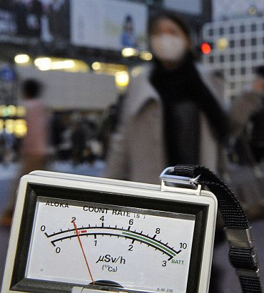 A radiation dosimeter indicates 0.6 microsieverts in Shibuya