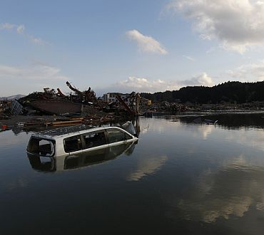 A car sits submerged in water in Minamisanriku town, Miyagi Prefecture