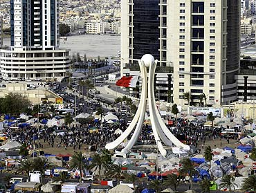 Protesters are seen at Pearl Square as GCC forces move in to evacuate the area in Manama