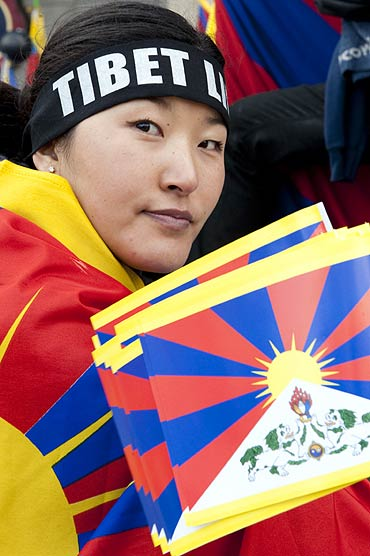 A pro-Tibet activist attends a demonstration in Paris