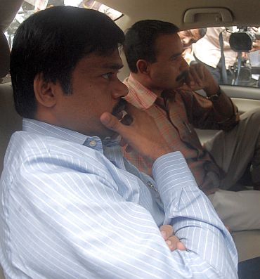 File photo shows Sadiq Batcha being taken away from his residence for questioning by Central Bureau Investigation