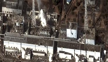 Smoke coming out of the Fukushima Daiichi nuclear plant in Japan, in this satellite picture