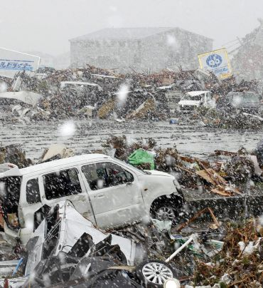 Heavy snow falls on a factory area devastated by an earthquake and tsunami in Sendai