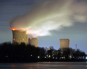 The Three Mile Island nuclear power plant, where the U.S. suffered its most serious nuclear accident in 1979, is seen across the Susquehanna River in Middletown, Pennsylvania in this night view taken March 15
