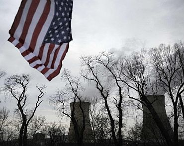 A US flag flies near the cooling towers of the Three Mile Island nuclear power plant in Pennsylvania