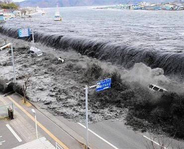 A wave approaches Miyako City from the Heigawa estuary in Iwate Prefecture after the magnitude 8.9 earthquake struck the area March 11