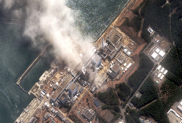 The No 3 nuclear reactor of the Fukushima Daiichi nuclear plant is seen burning after a blast