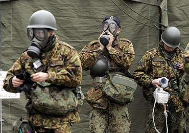Japan Self-Defense Force officers prepare for a clean-up at a radiation affected area in Nihonmatsu, Fukushima