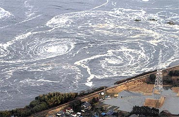 Whirlpools are caused by a tsunami in Fukushima prefecture on March 11