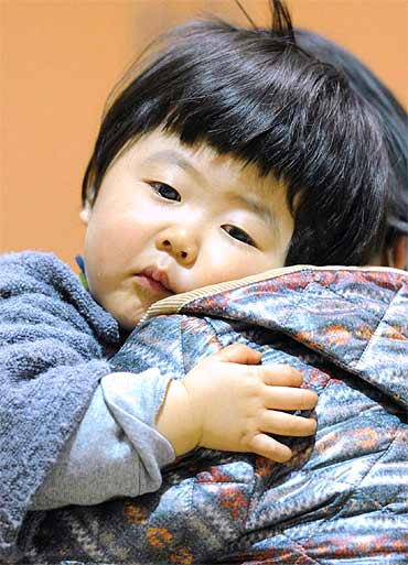 A child who was evacuated from the vicinity of Fukushima Daiichi Nuclear Plant is pictured in Kawama