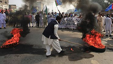 Angry Pakistanis burn tyres in Peshawar while demonstrating against the release of Davis