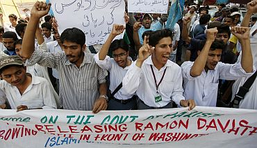 Students shout slogans as they take part in a protest in Karachi