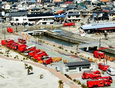 Fire engines in Iwaki city, Fukushima prefecture, prepare to head to Fukushima Daiichi nuclear plant