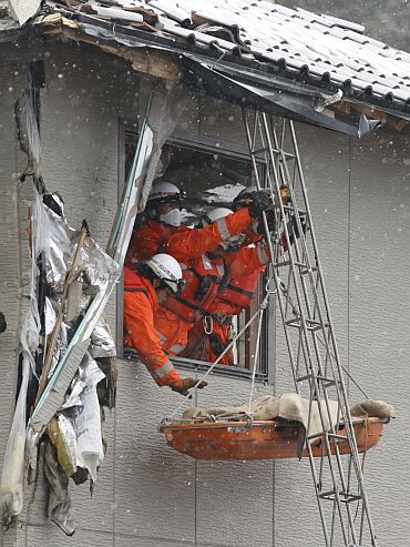 Firefighters in a village destroyed by the earthquake and tsunami in Kamaishi, Japan