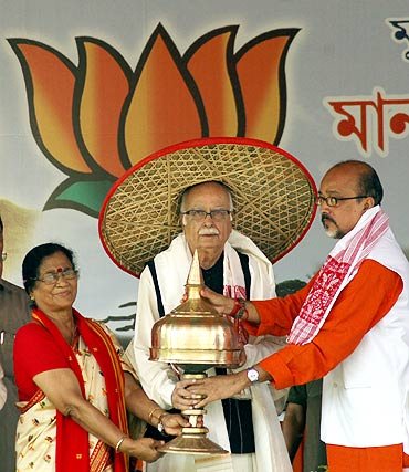 Senior BJP leader Lal Krishna Advani is felicitated by former Assam state BJP president Ramen Deka and BJP leader Bijoya Chakraborty during a public meeting in Guwahati