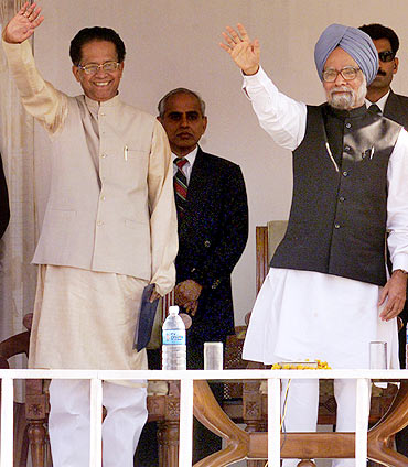 Prime minister Manmohan Singh waves to the crowd along with CM Tarun Gogoi during a function in Dispur