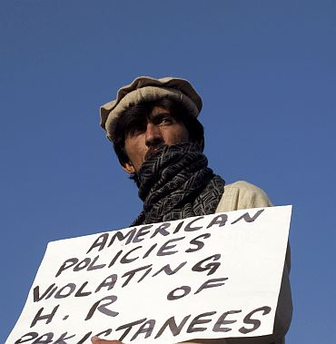 A Pakistani tribesman from North Waziristan tribal region holds a placard during a protest near the parliament house in Islamabad