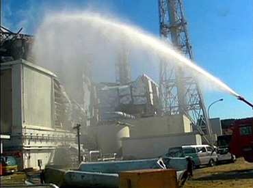 A fire truck sprays water at No. 3 reactor of the Fukushima Daiichi nuclear power plant
