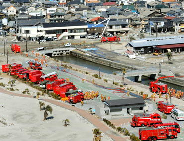 Fire engines in Iwaki city, Fukushima prefecture, prepare to head to Fukushima Dai-ichi nuclear plant