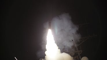 Arleigh Burke-class guided-missile destroyer USS Stout (DDG 55) launches a Tomahawk missile in support of Operation Odyssey Dawn in the Mediterranean Sea