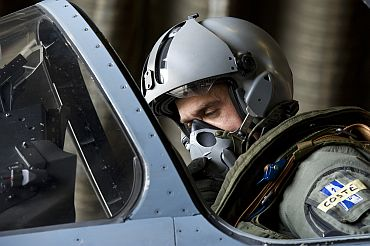 Pilot sits in Mirage aircraft cockpit before mission to overfly Libyan airspace in Dijon military base