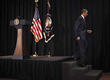 US President Barack Obama walks from a lectern after announcing limited US military operations against Libya, in Brasilia
