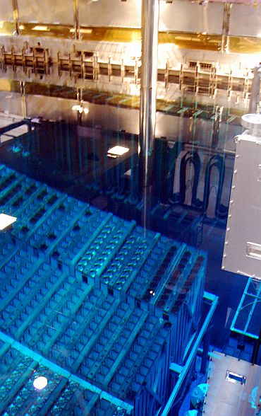 Plutonium-uranium mixed oxide fuel rods are placed in a storage pool at the No 3 reactor of the Fukushima Daiichi nuclear power plant in this picture taken August 21