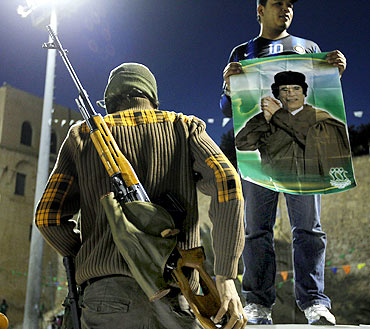 A soldier from the Libyan army loyal to Gaddafi stands at Green Square in Tripoli.