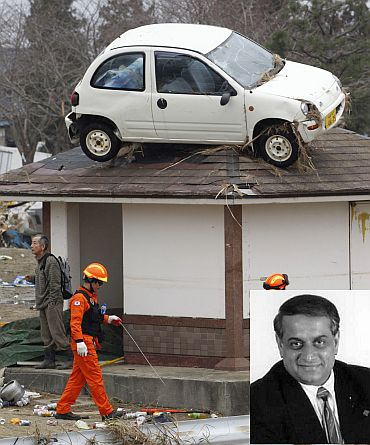 A car is seen on the rooftop of a house as a rescue worker walks past it in an area hit by an earthquake and tsunami in Sendai. (Inset) Parmesh Bhatt