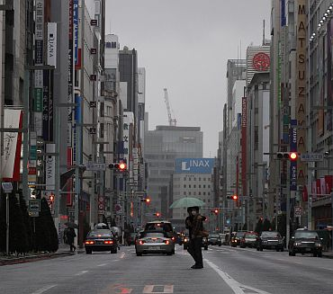 Pedestrians cross a street in Tokyo's Ginza shopping district