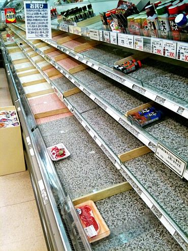 Near-empty shelves at a supermarket in Tokyo
