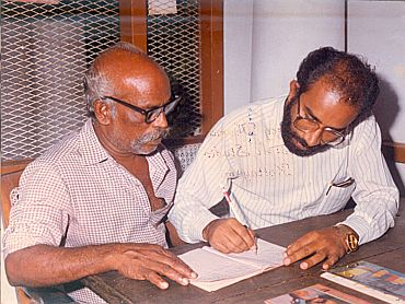 Then Kottayam collector Alphons Kannanthanam teaches an elderly person