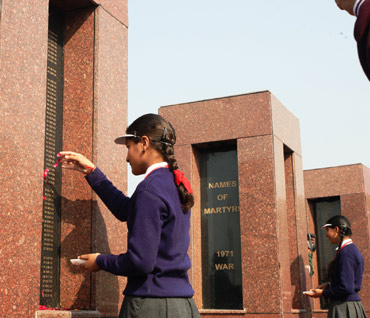 A schoolgirl pays tribute at the memorial