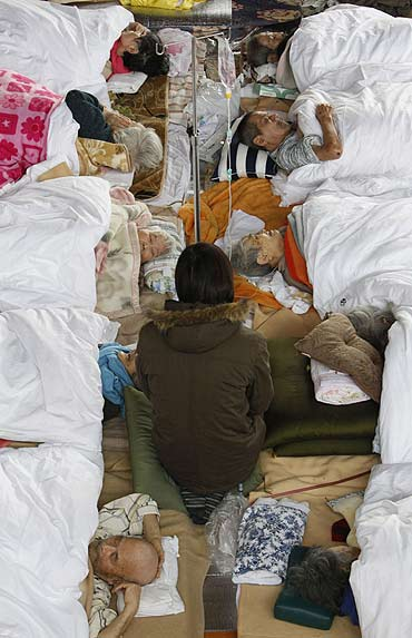 Elderly Japanese people receive medical treatment at an evacuation shelter in Kesennuma, Miyagi Pref