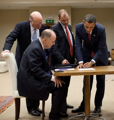 President Barack Obama works on his statement concerning the situation in Libya with, from left, Chief of Staff Bill Daley, National Security Advisor Tom Donilon, and Deputy National Security Advisor for Strategic Communication Ben Rhodes