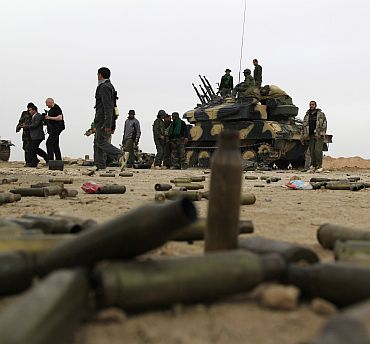 Empty cartridges left near Libyan government soldiers at the west gate of Ajdabiya town