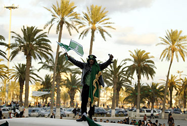 A supporter of Libya's leader Muammar Gaddafi chants slogans during a daily protest at Green Square