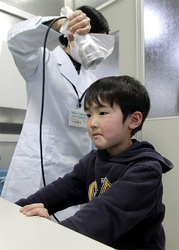 Yuya Sato, from Soma in Fukushima, undergoes a screening test for signs of nuclear radiation