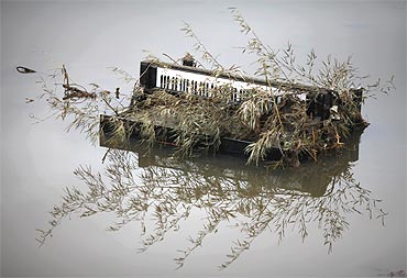 A piano is submerged in water in the area devastated by tsunami in Rikuzentakat