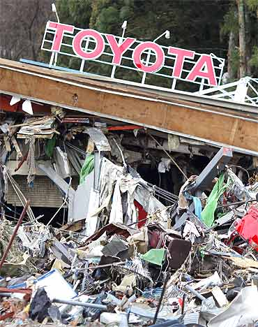 A Toyota dealership is seen at a devastated area after the earthquake and tsunami, in Minamisanriku town, Miyagi prefecture